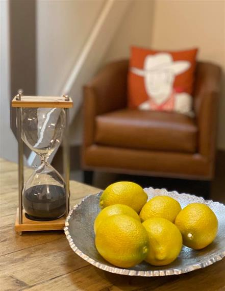 decorative lemons and an hour glass