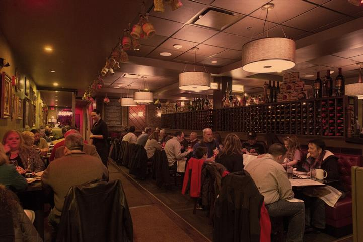 crowded dining area with customers sitting at tables