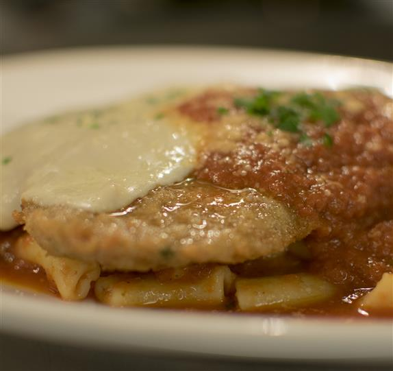 chicken parm with pasta and sauce
