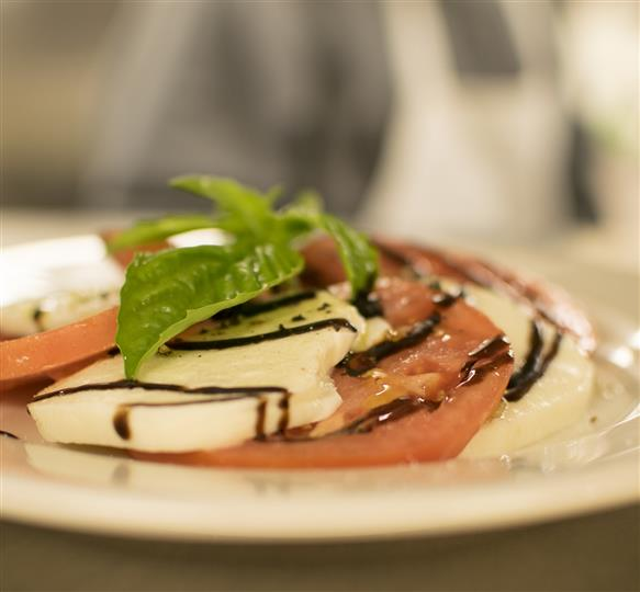 caprese salad with basil leaves