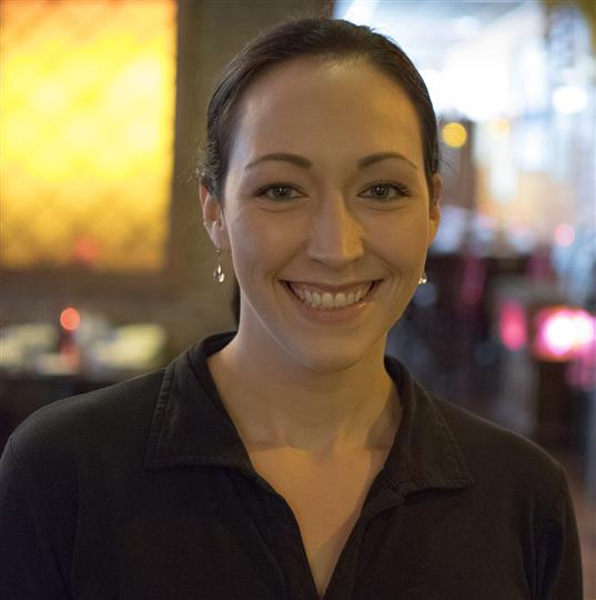 waitress smiling for the camera