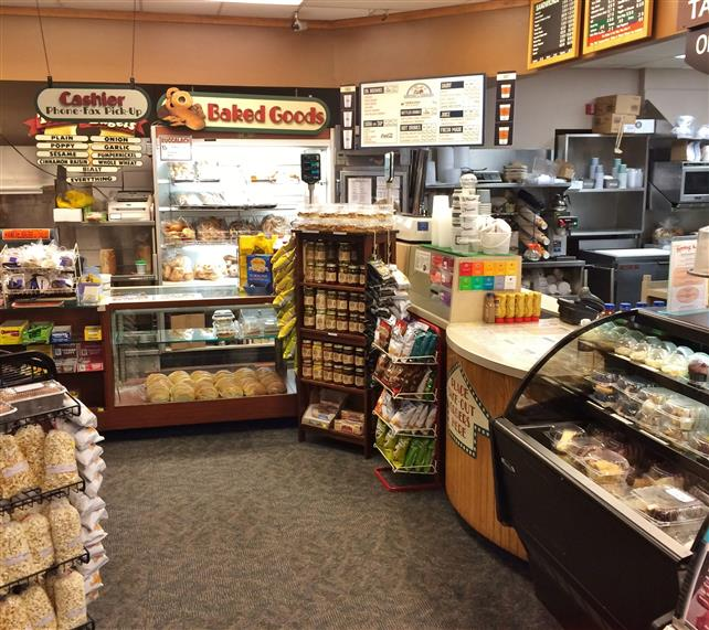 Deli counter, bread cases, food display racks.