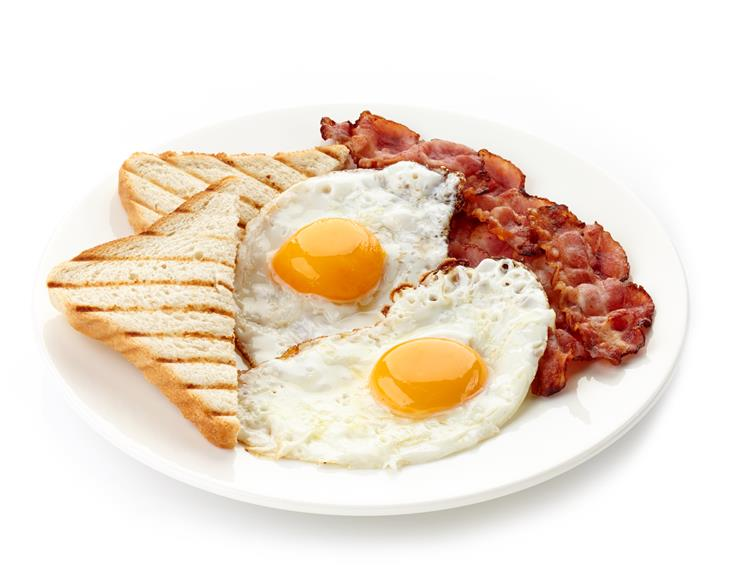2 eggs sunny side up with bacon and 1 slice of toast