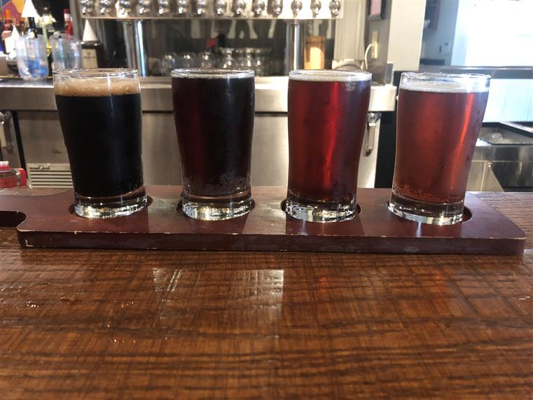 Dark beer flight on bartop.