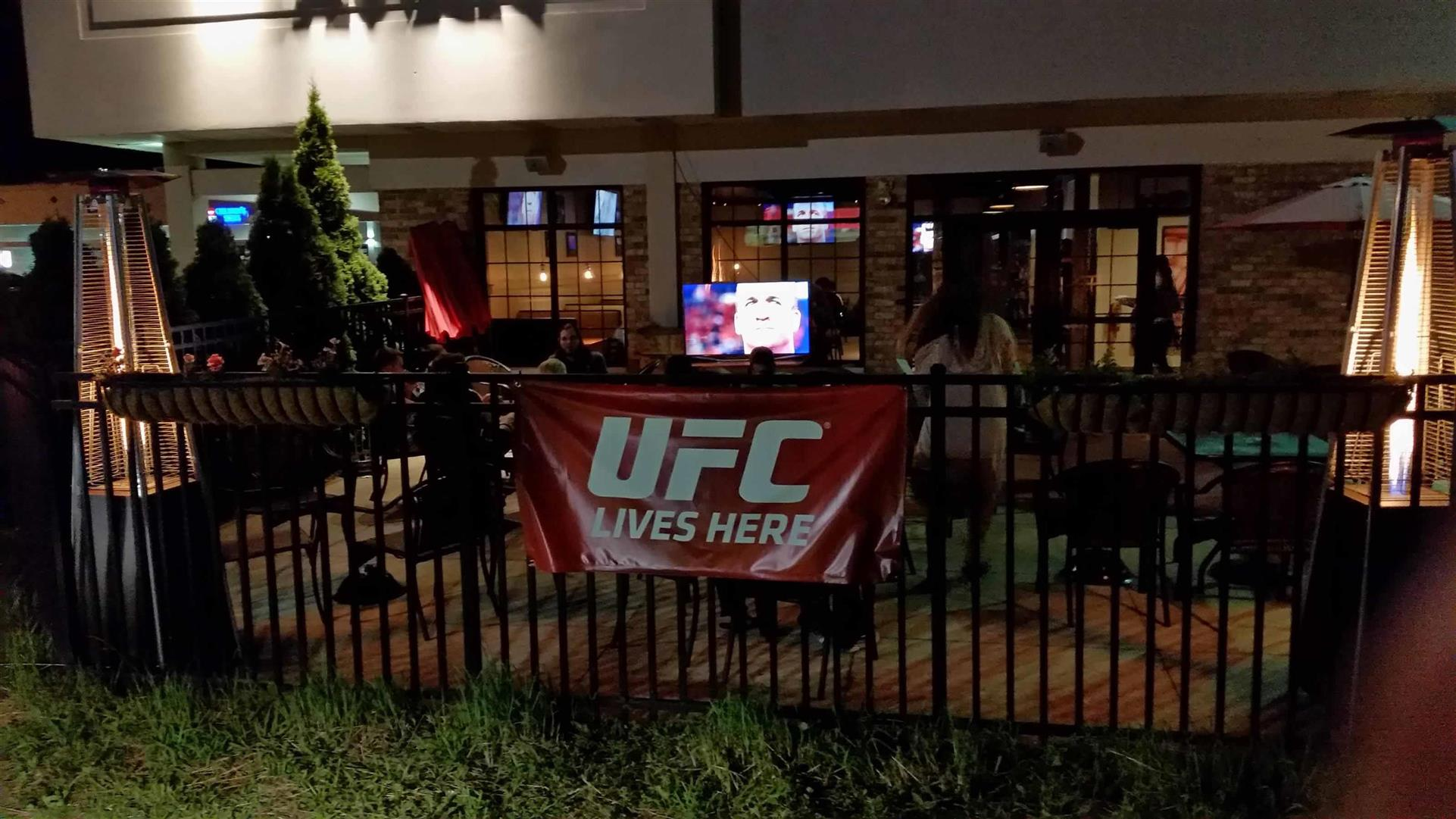 UFC Sign hanging over fence