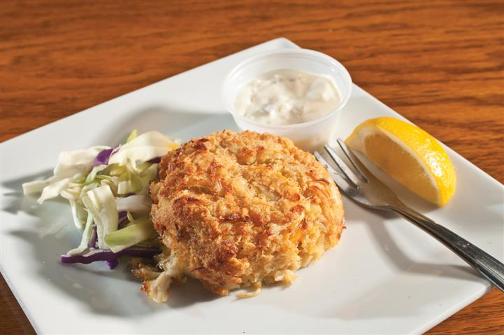 Crab cake over mixed greens