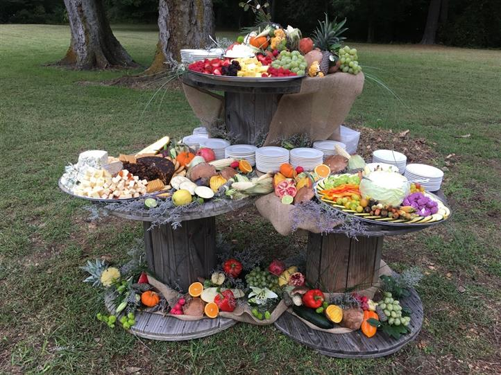 Catering displays with various fruits and vegetables.