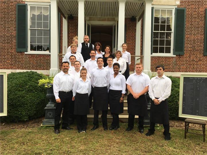 Island House Restaurant staff on lawn in front of building