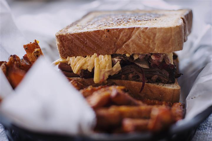 pulled pork on toast with a side of sweet potato fries