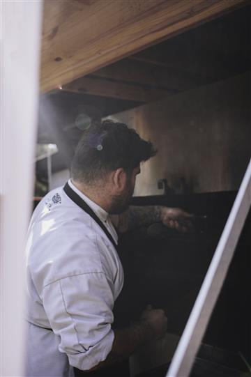 chef putting the brisket in the stove