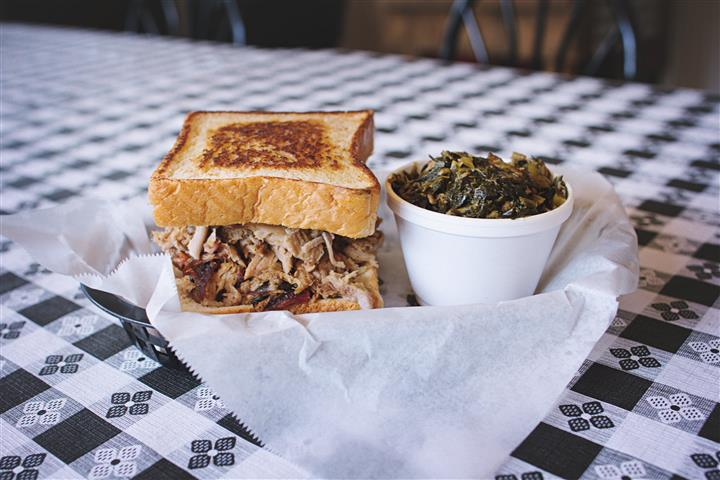 pulled pork on toast with a side of collard greens