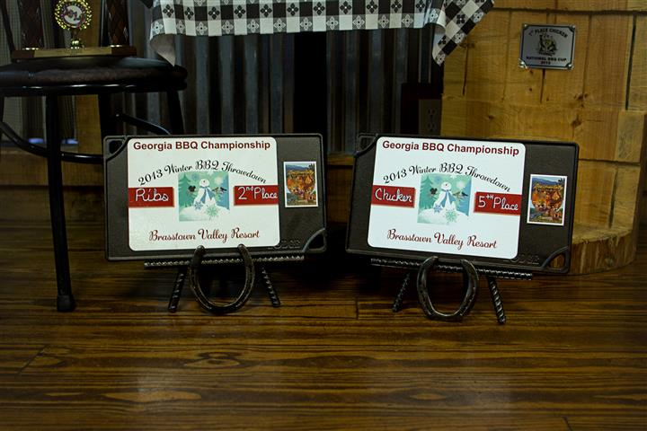 "two awards proclaiming, ""Georgia BBQ Championship, 2nd Place Ribs and 5th Place Chicken"""