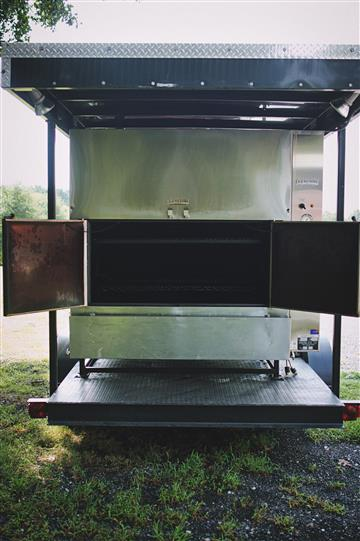 a large grill on a trialer