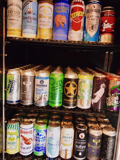 various canned beers in a fridge