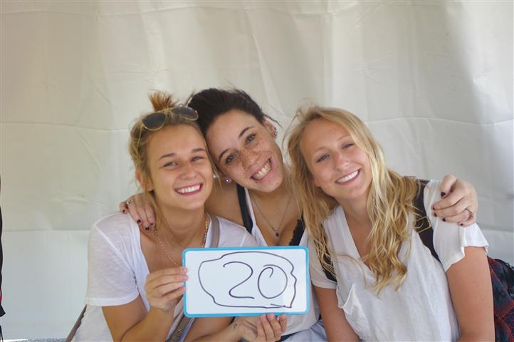 "women with sign that reads ""20"""