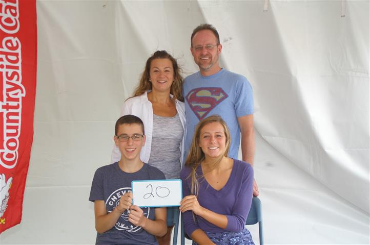 "family with sign that reads ""20"""