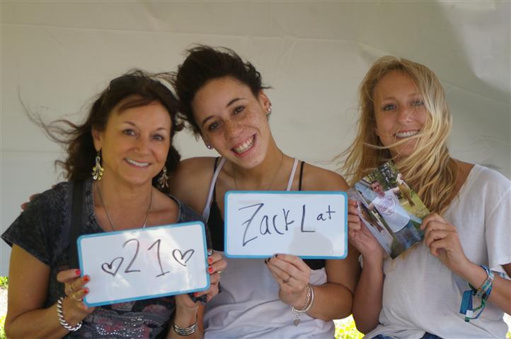 "family with signs that read ""21"" and ""Zack L at"""