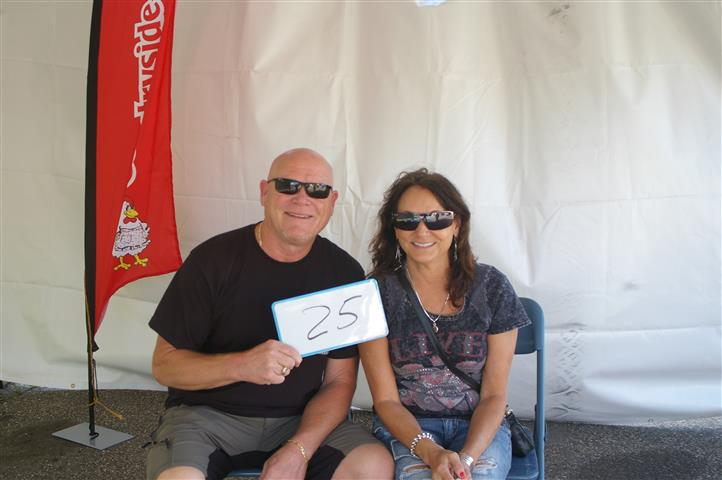 """couple with sign that reads """"25"""""""