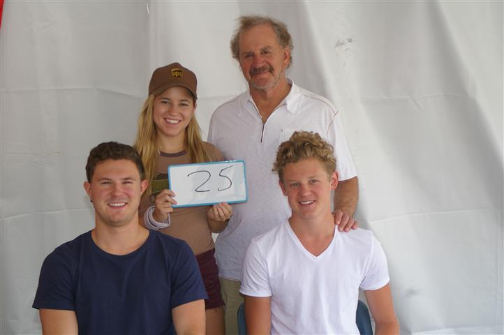 "family with sign that reads ""25"""