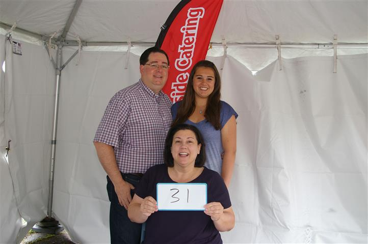 """family with sign that reads """"31"""""""