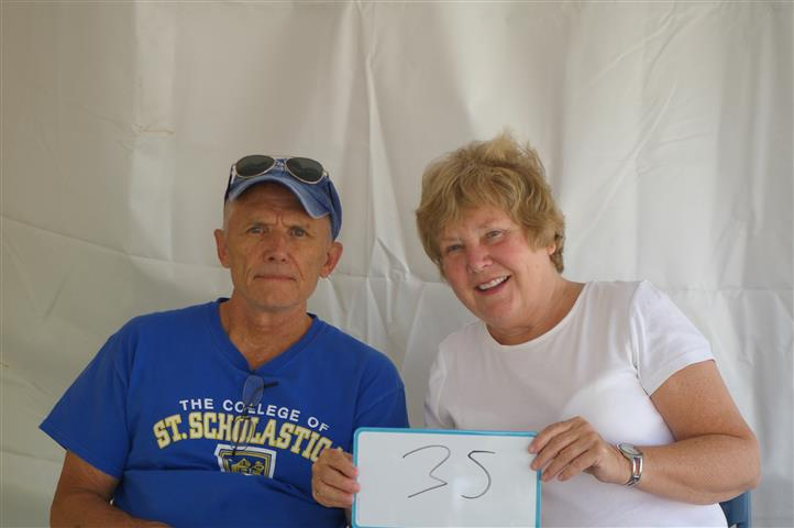 "couple with sign that reads ""35"""