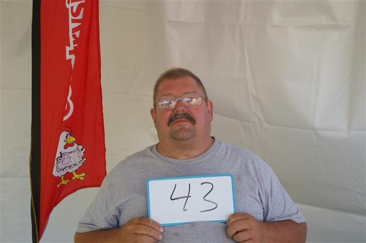"man holding sign that reads ""43"""