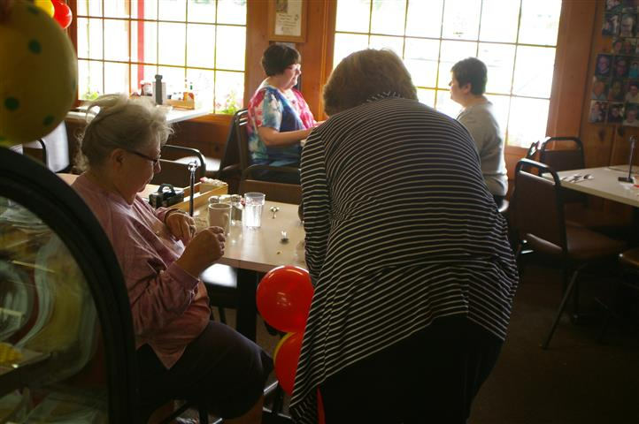family at table with balloons