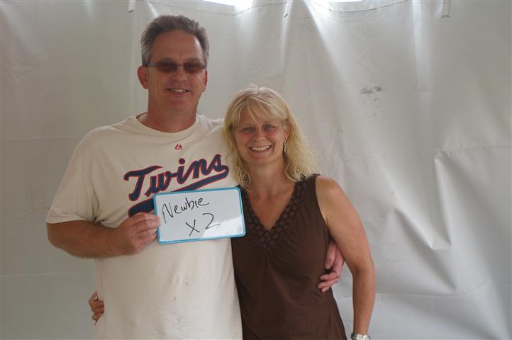 """couple holding a sign that reads """"newbie x2"""""""