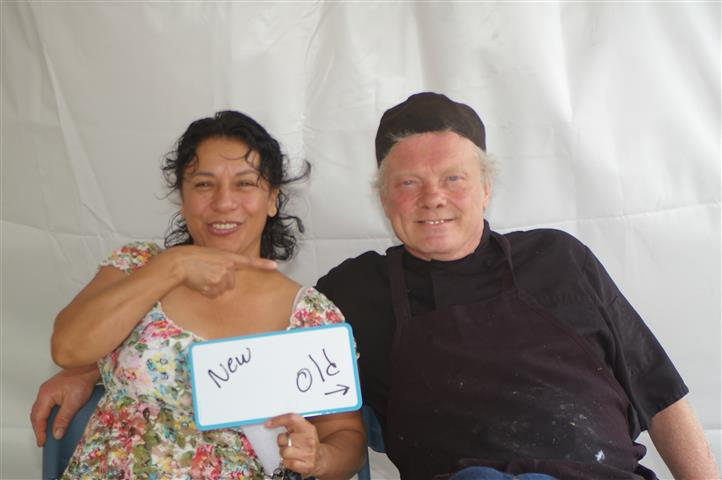 """couple holding a sign that reads """"new, old"""""""