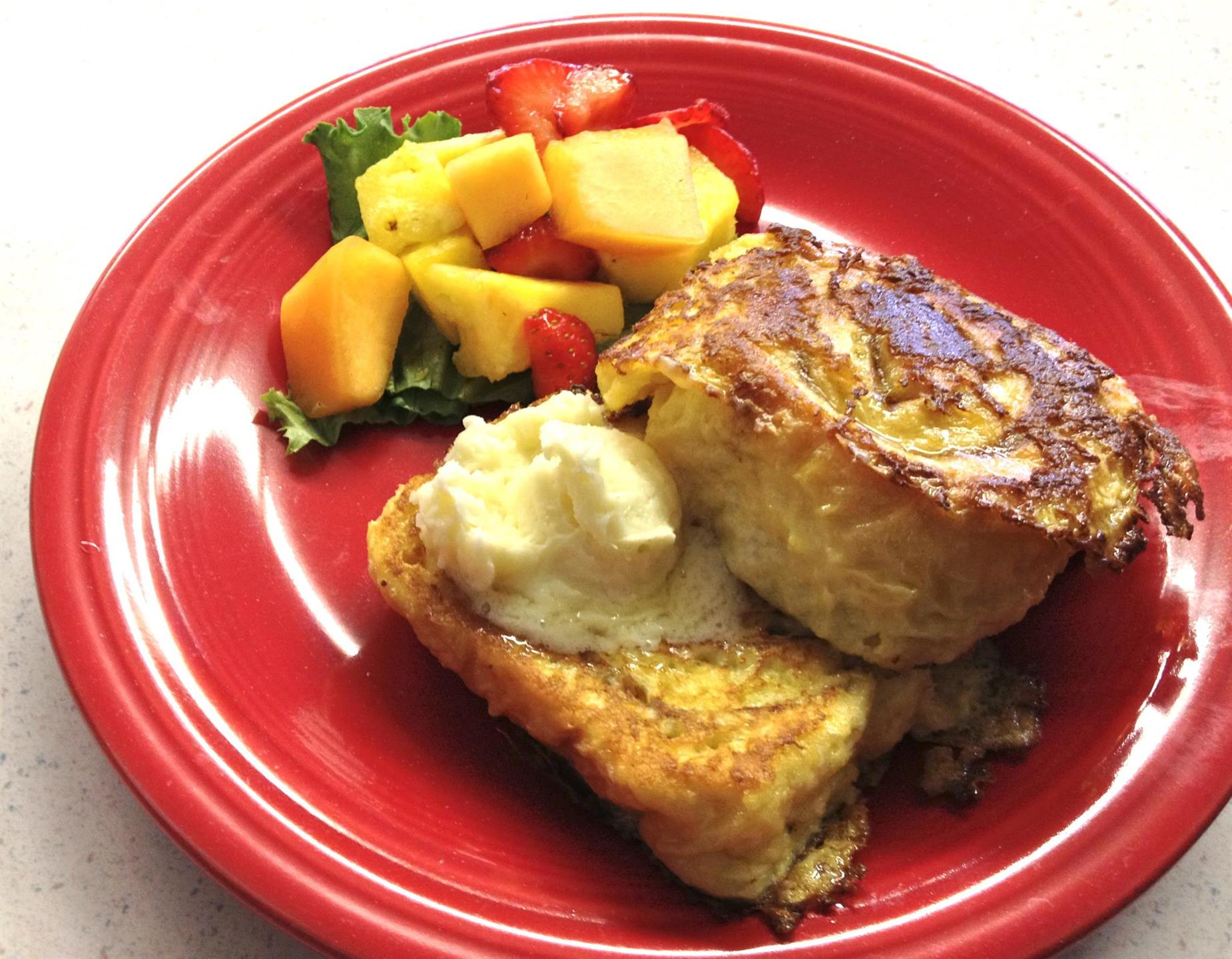 french toast with side of fruit salad