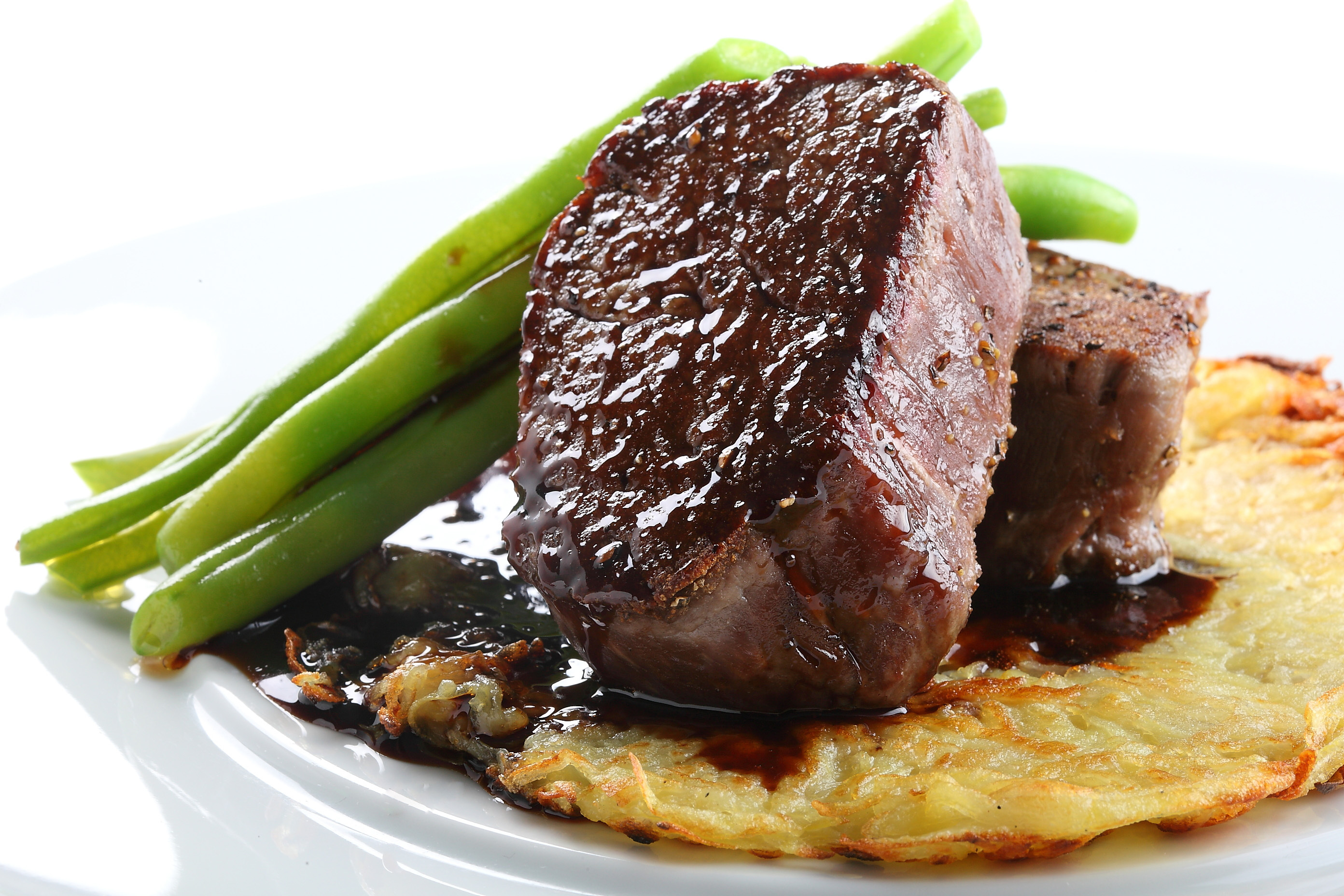 Steak over potatoes and asparagus