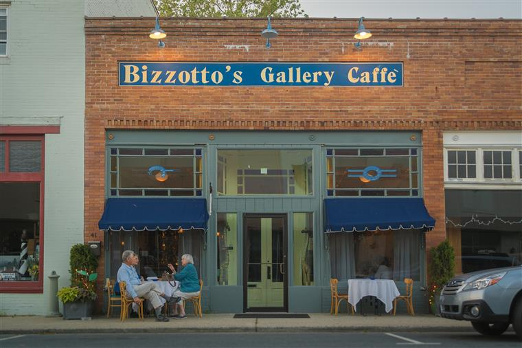Bizzotto's gallery cafe front entrance on brick building