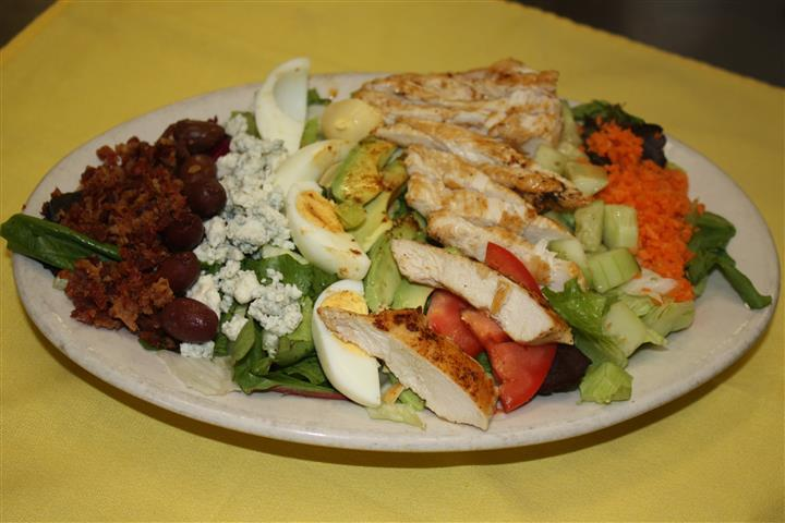salad with grilled chicken, eggs, bleu cheese and various vegetables