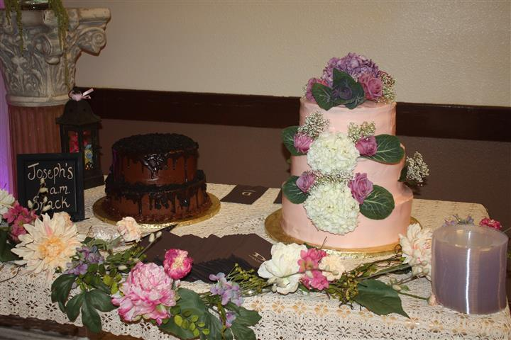 a two-tiered chocolate cake and a three-tiered pink cake