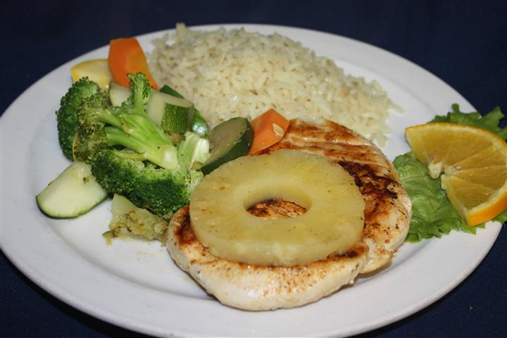 grilled chicken with pineapple, and a side of rice and various vegetables