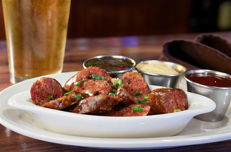 BANGER BITES. Smoked cracked black pepper sausage made exclusively for Celts Craft House. Sliced, grilled and served with hot mustard, house-made Pepper Jelly and house-made BBQ sauce.