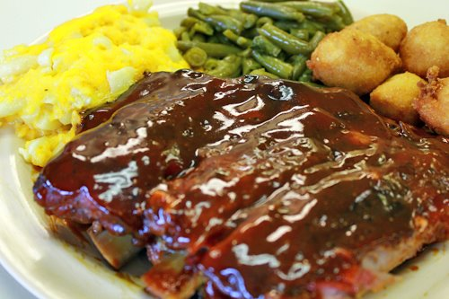 bbq ribs with a side of vegetables