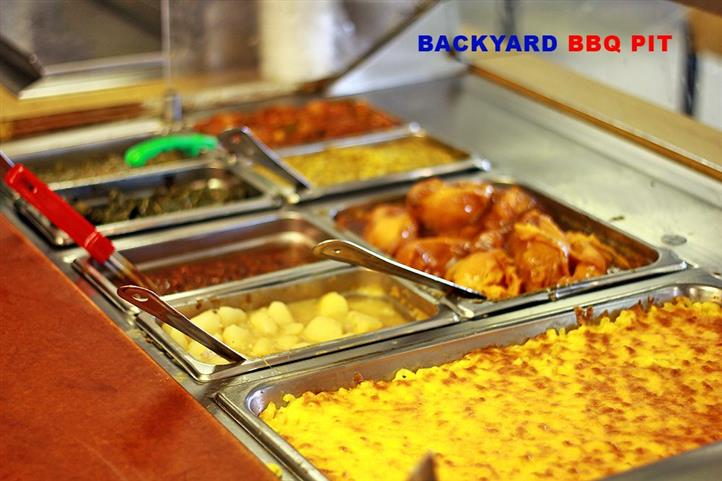buffet style metal containers with bbq food
