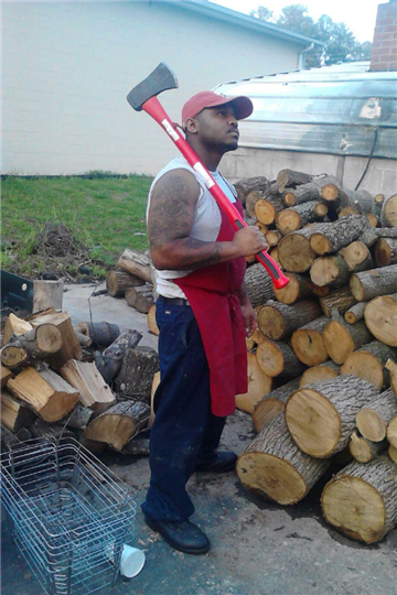 pitmaster outside gathering wood for the smoker