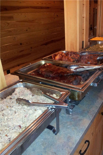 catering style buffet metal trays with bbq food