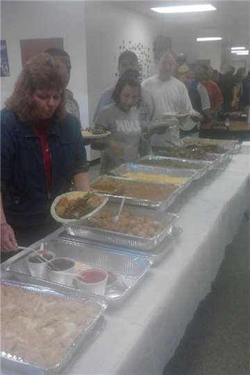 catering party with people lined up to get food