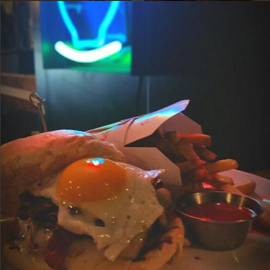 burger with egg on it and fries