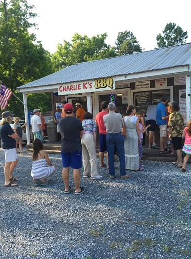 people waiting in line to order from charlie k's bbq