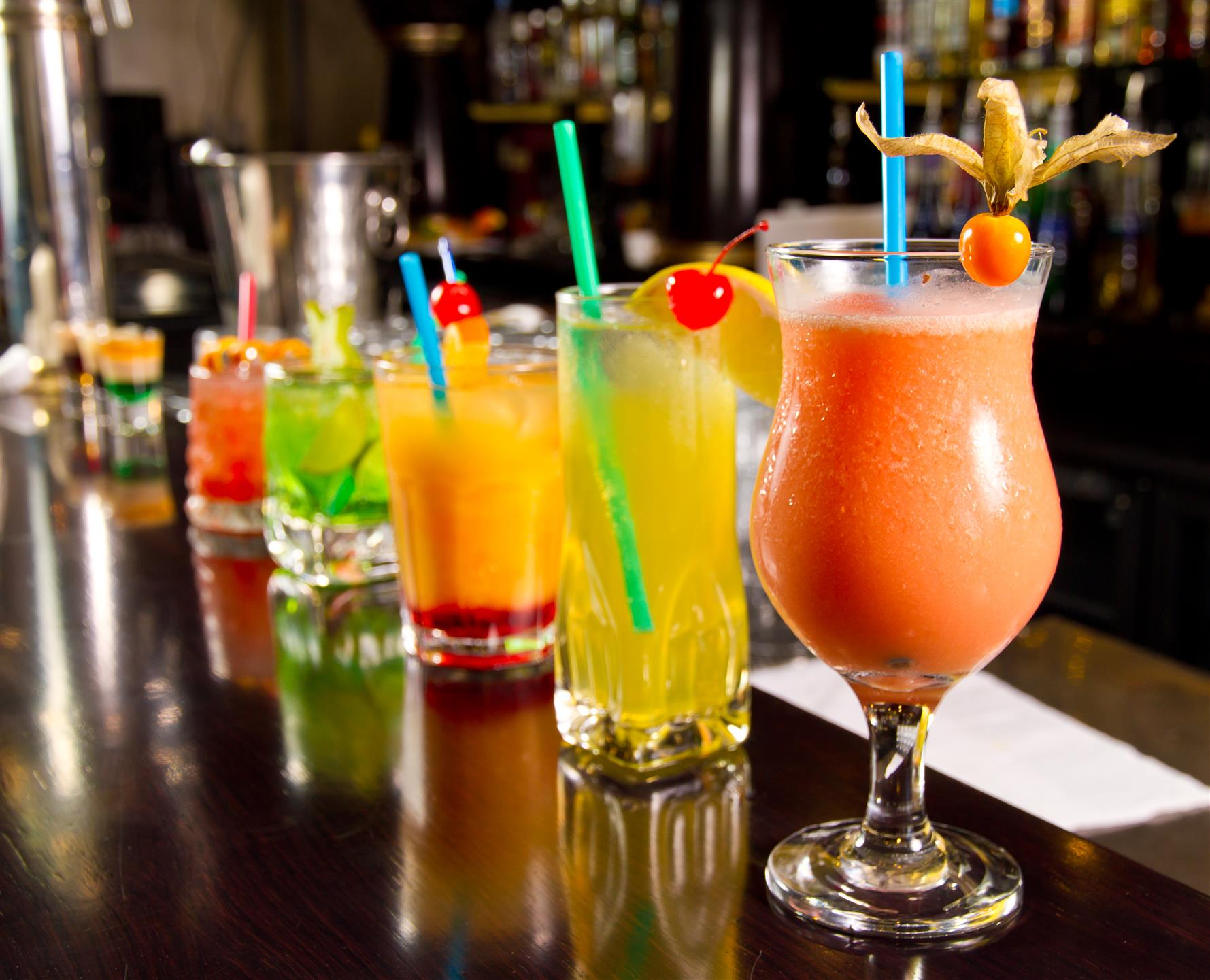 a row of various alcoholic beverages