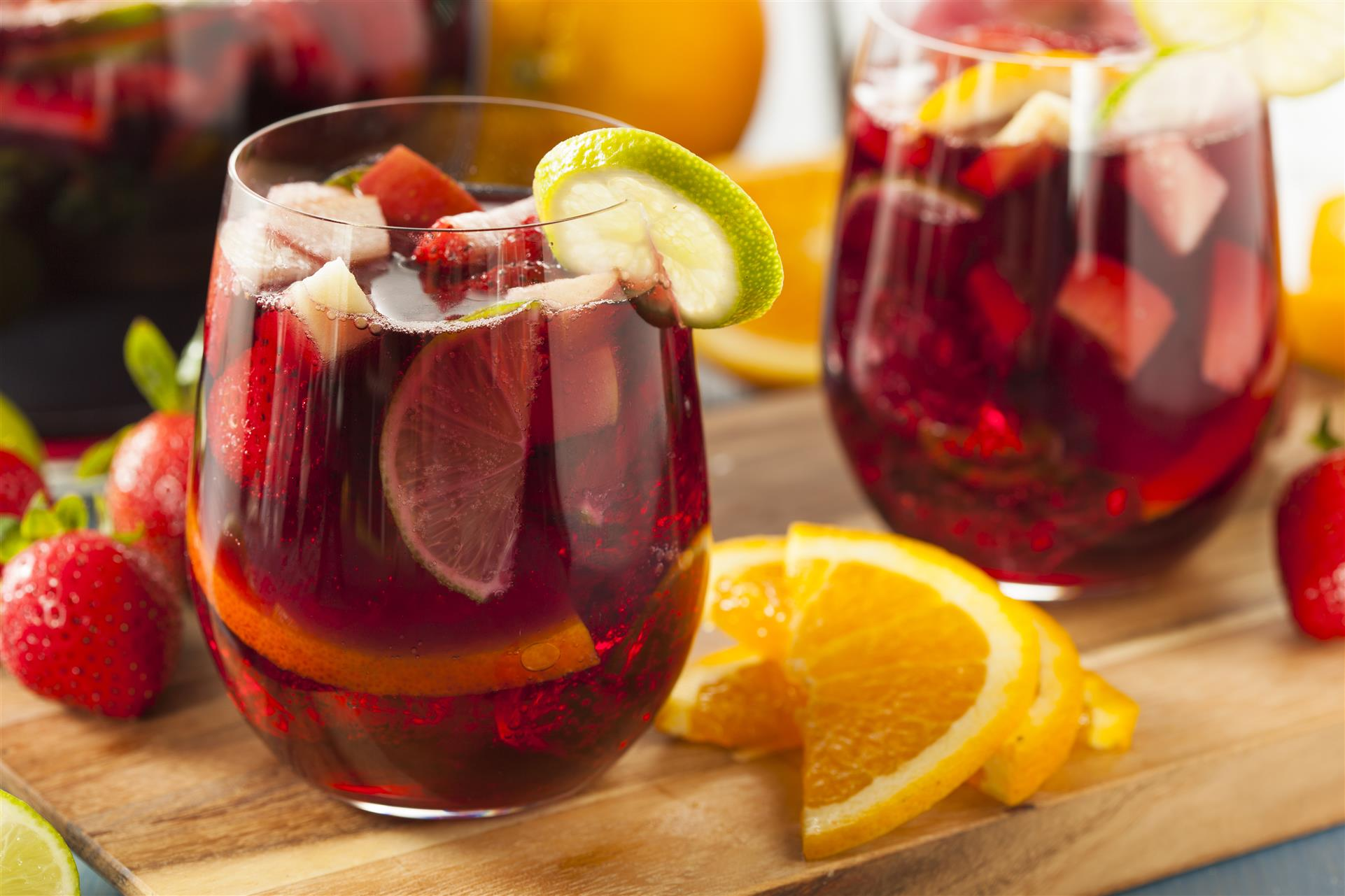 2 cups of sangria with citrus garnish