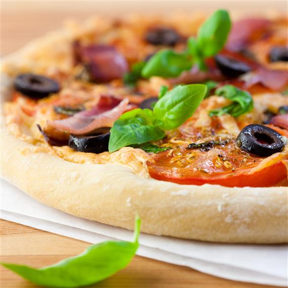 pizza with olives, onions and basil