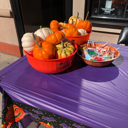 pumpkins and a bowl of candy