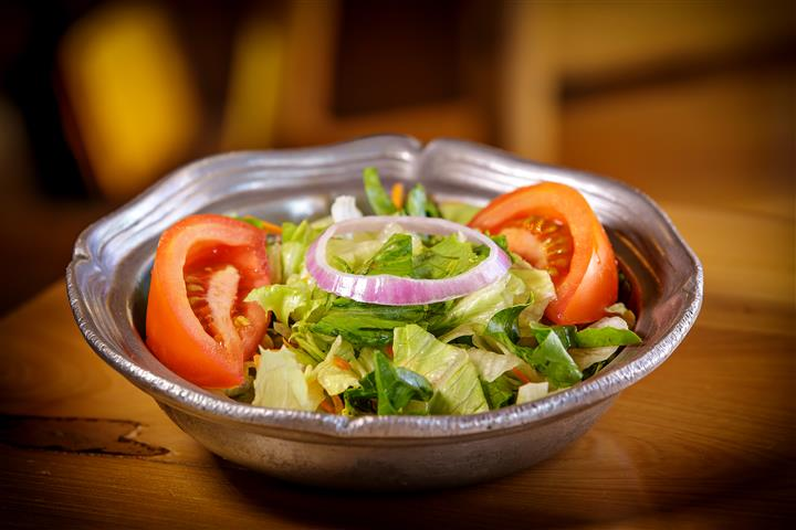 salad in a bowl with tomatoes, onions and lettuce