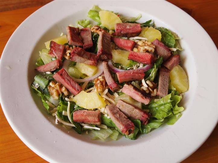 salad with lettuce, steak and pineapple slices