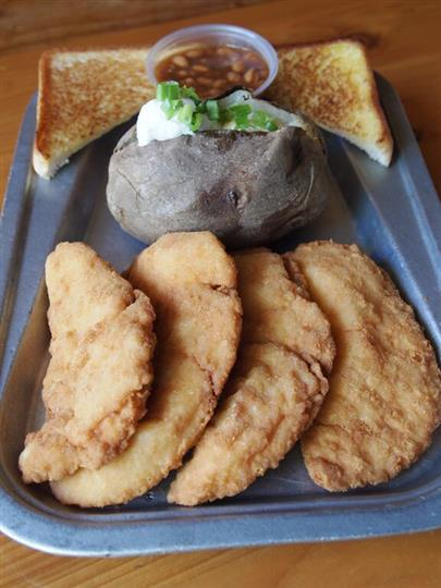 chicken cutlets with toast and a baked potato